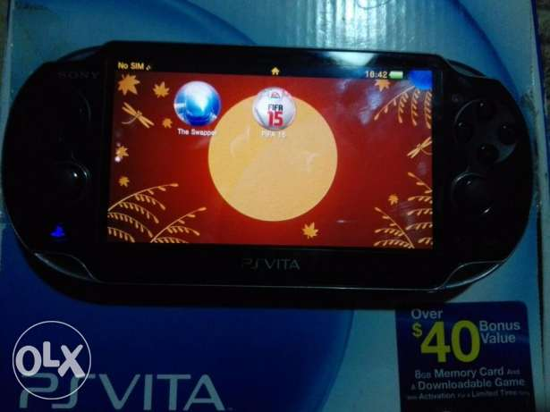 PS Vita + 8GB Memory + FIFA 15 - The Swapper الإسكندرية -  1
