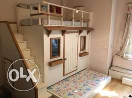two beds with play room and stairs